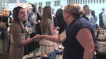 shaking hands at trade event
