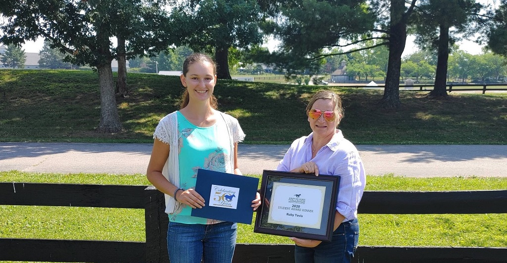 student receiving equine media award